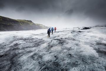 People hike in a glacier