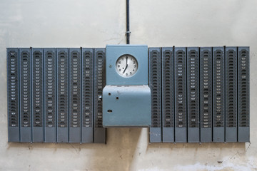 Symmetrical shot of an old mechanical timeclock found in an abandoned factory