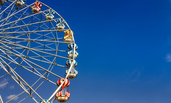 Colorful ferris wheel under the blue sky