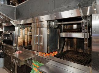 Heavy duty grill in professional restaurant kitchen