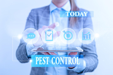 Word writing text Pest Control. Business photo showcasing Killing destructive insects that attacks crops and livestock Female human wear formal work suit presenting presentation use smart device