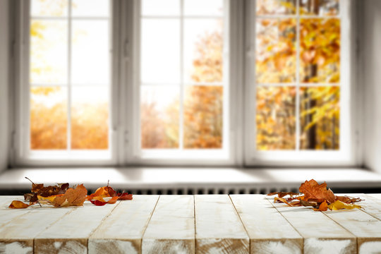 Fall wooden window sill and free space for your decoration.