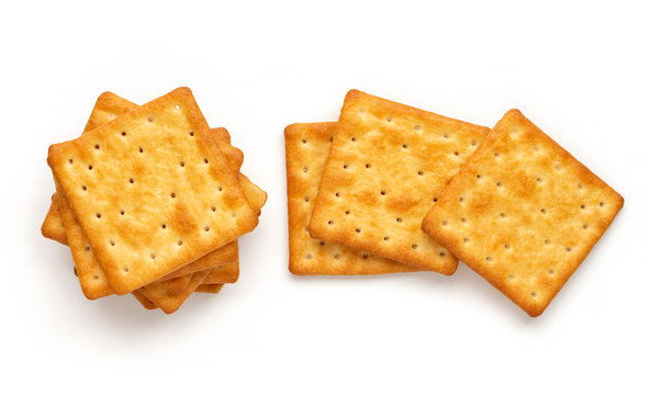 Crushed dry cracker cookies isolated on white background.