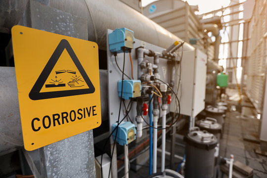 Dangerous corrosive warning signs and symbol applying where chemical substance storage used on construction site