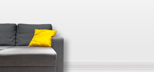 Living room interior grey sofa with yellow pillow, copy space