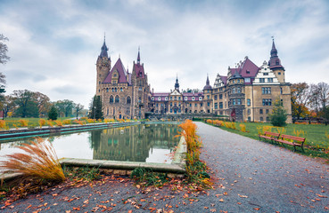 MOSZNA, POLAND - OCTOBER 24, 2017 ; The Moszna Castle, built in the XVII century, extended from 1900 to 1914, is a historic palace in Moszna, is one of the best known monuments in Upper Silesia. Fototapete