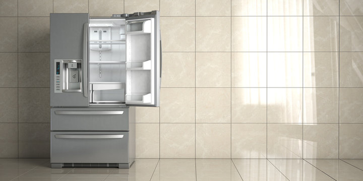 Side by side stainless steel refrigerator on white ceramic tile background. Open fridge in the empty kitchen.