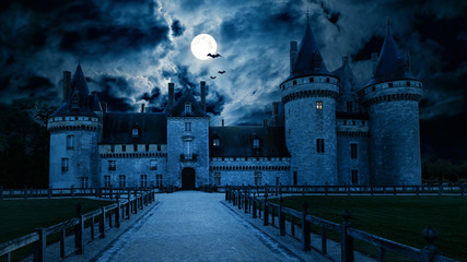 Haunted Gothic castle at night. Old spooky house in full moon. Creepy view of dark mystery castle with bats. Scary gloomy scene for Halloween theme. Horror and terror concept.