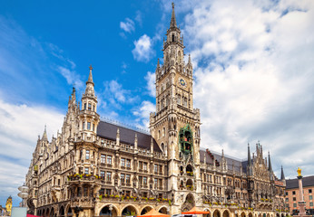 Fototapete - Marienplatz square in Munich, Bavaria, Germany. Beautiful view of Town Hall or Rathaus. It is a famous landmark of Munich. Panorama of Gothic tourist attraction of old Munich city center in summer.