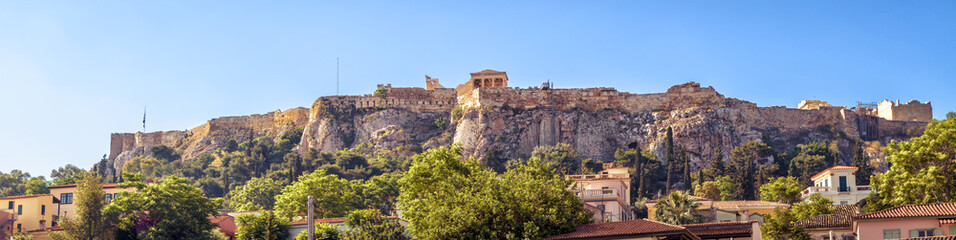 Fototapete - Panorama of Acropolis hill in summer, Athens, Greece. Acropolis is a top landmark of Athens. Scenic view of the old Athens center. Landscape of the Athens city with Ancient Greek and medieval ruins.