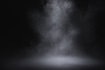empty floor with smoke on dark background