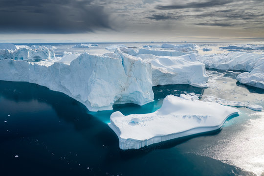 Aerial view of large glacier and iceberg