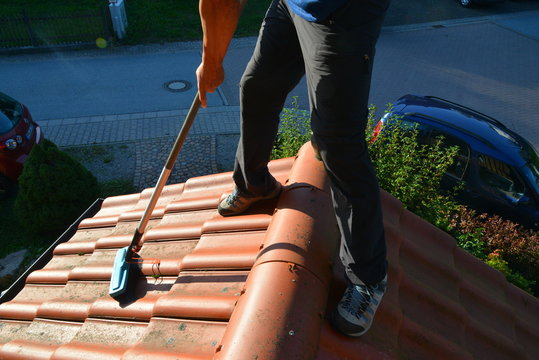 Spraying Roof Tiles with a Pressure Sprayer and algicide against Infestation of Algae, Lichen and Moss