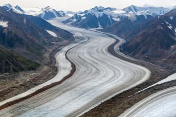 The Kaskawulsh Glacier flows through the mountains in Kluane National Park, Yukon, Canada