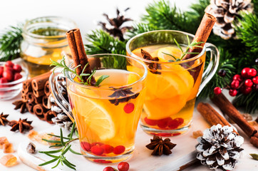 Spoed Foto op Canvas Thee Winter hot tea with lemon, cranberries, herbs and spices for Christmas or New Year evening, white background, copy space, selective focus