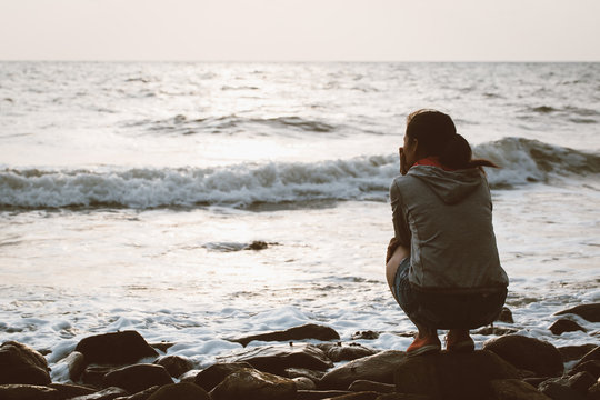 Silent depression that reflects society A woman sitting alone with loneliness and stress