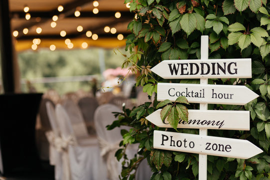 Sign for guests to help them to find the place of wedding, photo zone, cocktails, ceremony made from wood