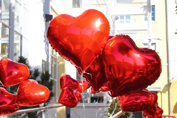Red shiny balloons in heart shape. Wedding decoration.