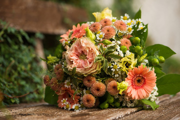 Colorful autumn flowers bouquet on a wooden bench