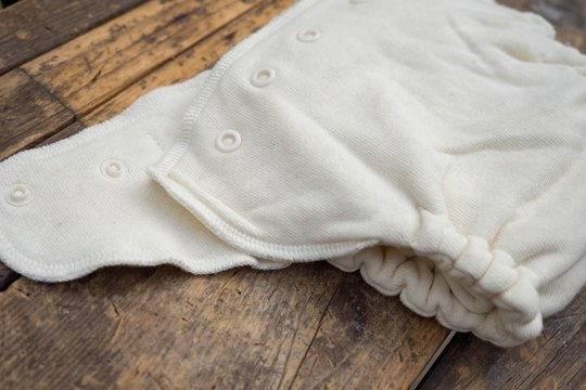 Closeup shot of organic white baby diapers on a wooden surface