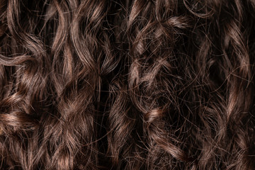 Long dark brown red color hair, wavy or half curly, close up background