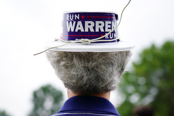 A man wears a hat supporting Elizabeth Warren, U.S. Senator and Democratic presidential hopeful, at the Polk County Democrats' Steak Fry in Des Moines
