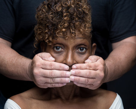 Black woman being silenced by white man in racism