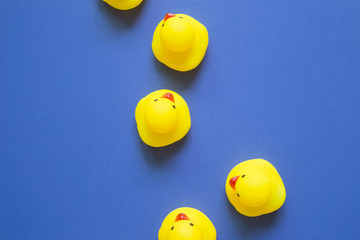 Yellow rubber duck doll on purple background