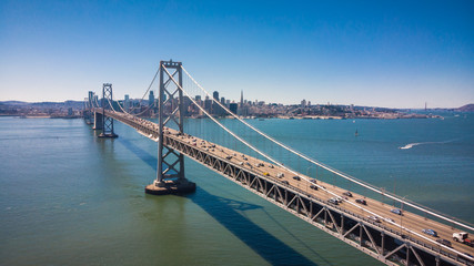 Fototapete - Aerial Cityscape view of the Bay Bridge and San Francisco