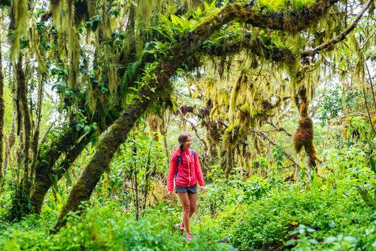 Galapagos tourist walking in Highland forest on Santa Cruz Island in Galapagos Islands.