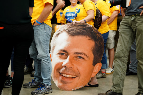 A supporter holds a large Pete head cutout at a campaign event for Pete Buttigieg, South Bend Mayor and Democratic presidential hopeful in Newton