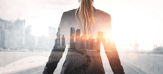 Double Exposure Image of Business Person on modern city background. Future business and communication technology concept. Surreal futuristic cityscape and abstract multiple exposure graphic interface.