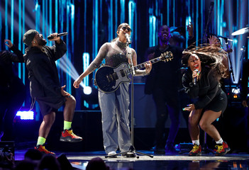 H.E.R. performs with backup singers during the iHeartRadio Music Festival at T-Mobile Arena in Las Vegas
