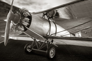 Vintage propeller airplane, sepia color style.
