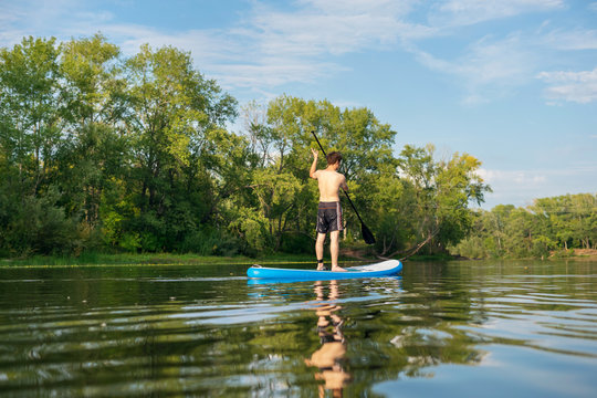 Man is training on a SUP board
