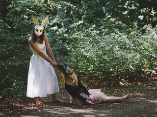 Creepy women in rabbit mask at forest