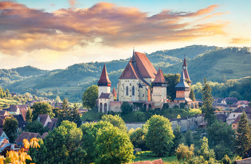 Splendid summer view of Fortified Church of Biertan, UNESCO World Heritage Sites since 1993. Colorful morning cityscape of Biertan town, Transylvania, Romania, Europe. Traveling concept background. Wall mural