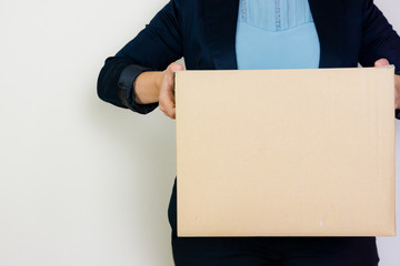 Woman holding box on white background
