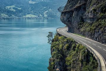 Fototapeta Road built in the cliff in Switzerland obraz