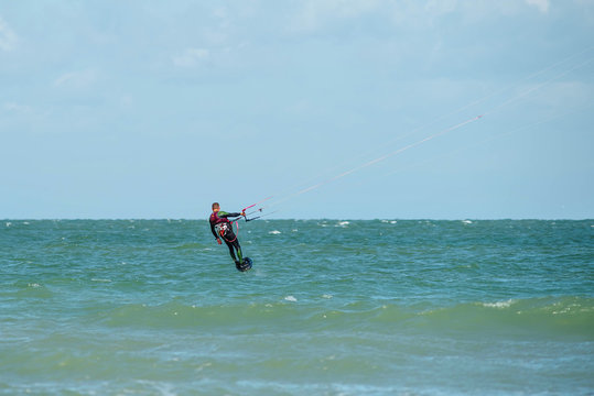 kite surfer on his hydrofoil flying over the sea