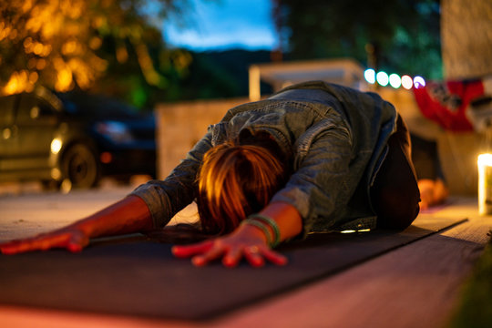 Yoga Stretching at Night by Candle Light