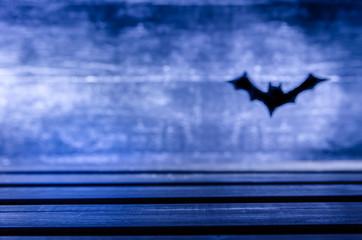 background for Halloween. Dark. Black bat flies.