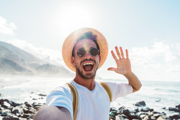 Young male hipster doing selfie in Tenerife, Canary Island
