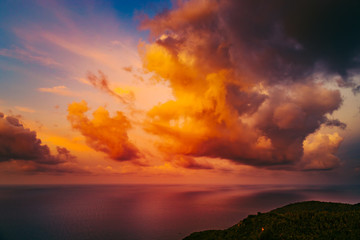 Evening Bottle Beach on Phangan Island Thailand Nature Landscape. Sunset over Oriental Exotic Tourism Coastline Aerial View from Climb. Panoramic Photo on Ocean and Amazing Orange Cloudy Sky