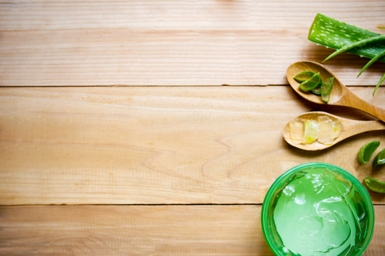 Aloe vera leaves and gels with copy space over table