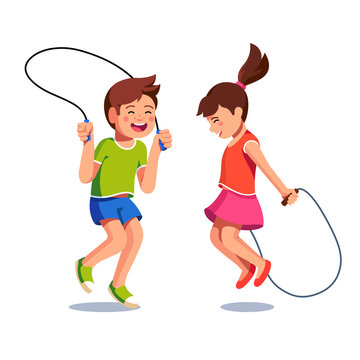 Happy boy and girl jumping up over skipping ropes