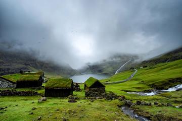 Popular village Saksun with little white church located on the island of Streymoy, Faroe Islands.