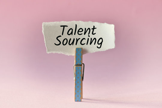 wooden pin holding small paper with text: talent sourcing
