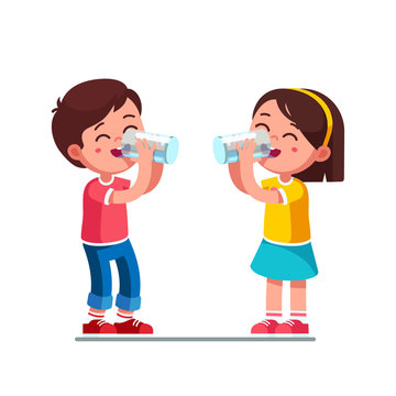 Boy and girl kids drinking water holding glasses