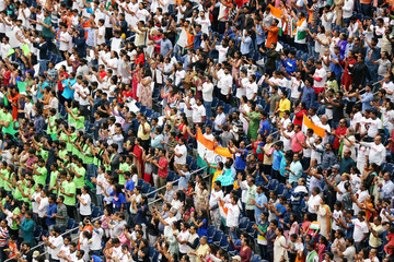 """People cheer during a """"Howdy, Modi"""" rally celebrating India's Prime Minister Narendra Modi at NRG Stadium in Houston"""